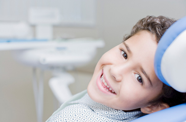 Young boy smiling with healthy teeth after getting dental sealants at Classic Smiles Family Dentistry in Ocoee, FL