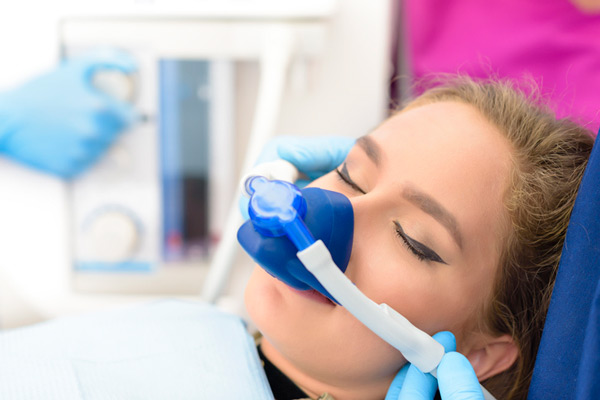 Safely sedated woman in dental chair at Classic Smiles Dentistry in Ocoee, FL